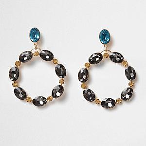 Gold tone and topaz oval gem hoop earrings