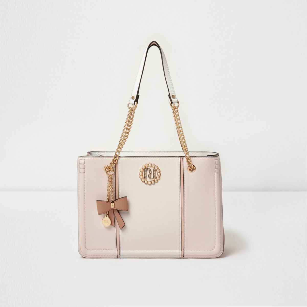 Light pink metallic tab faux pearl tote bag