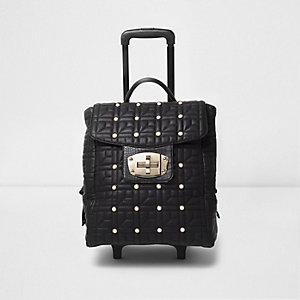 Zwarte gewatteerde koffer met studs en slot aan de voorkant