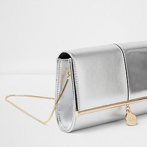 Silver metallic bar top charm clutch bag