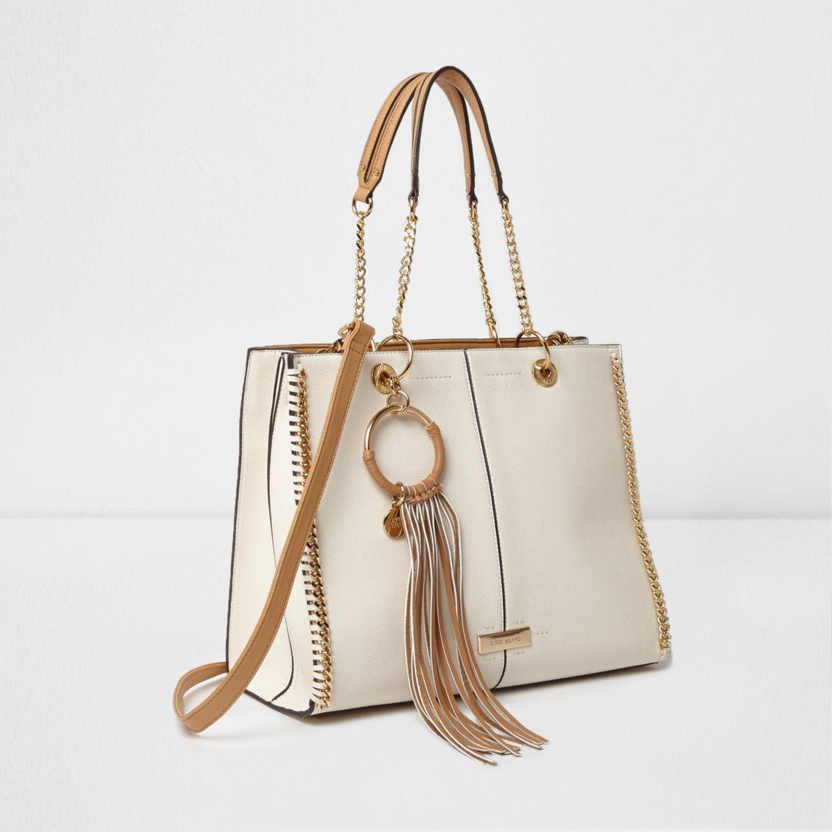 Cream and tan fringe hoop chain trim tote bag