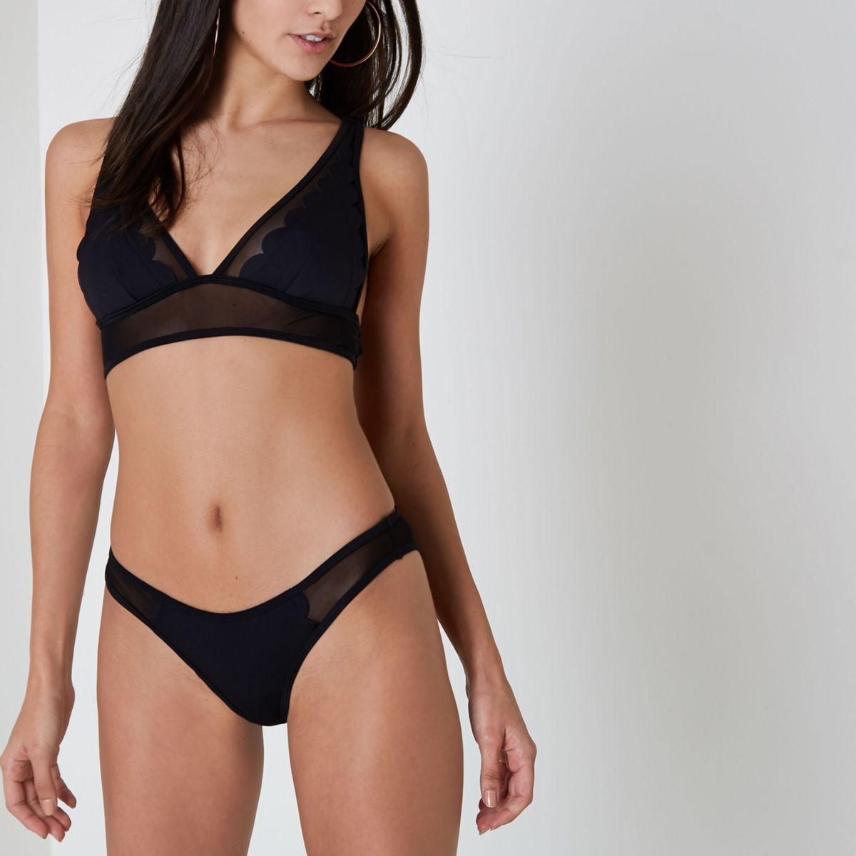 Bas de bikini échancré en néoprène noir festonné
