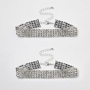 Set zilverkleurige glinsterende enkelbandjes met siersteentjes
