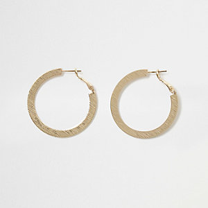 Gold tone flat textured hoop earrings
