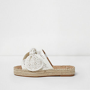 White laser cut bow espadrille mules