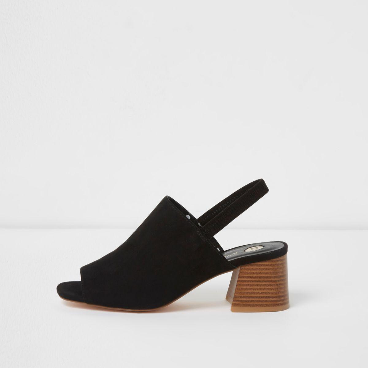 Black sling back block heel mules