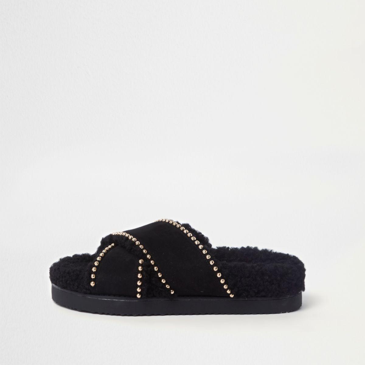 Black shearling footbed studded sliders