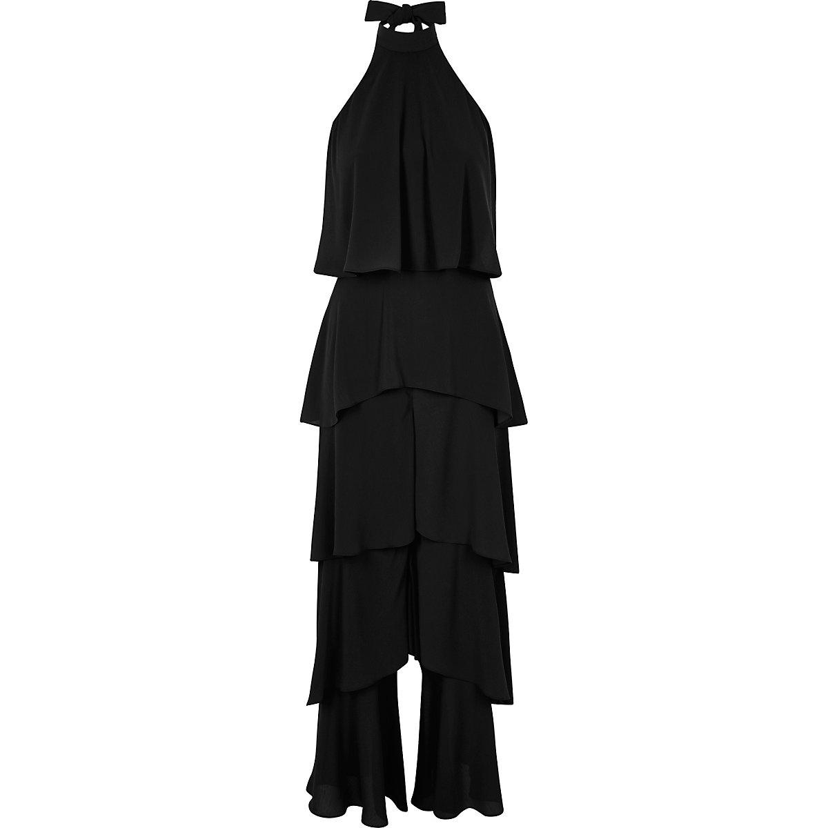 Zwarte jumpsuit met halter, wijde pijpen en ruches