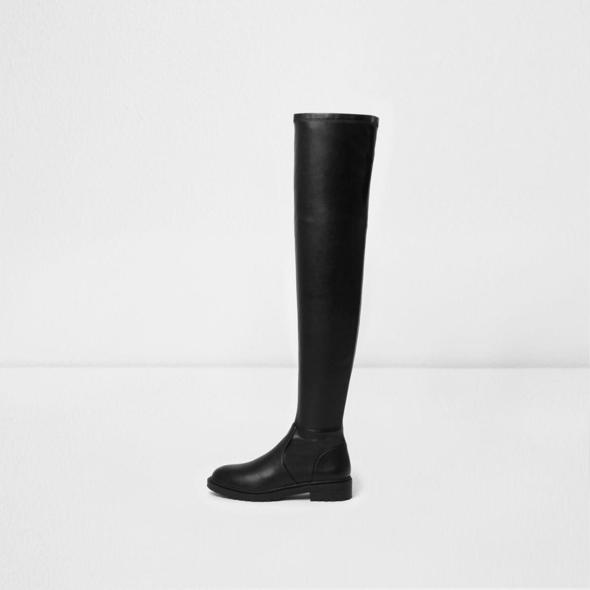 Zwarte laarzen tot over de knie met dikke zool