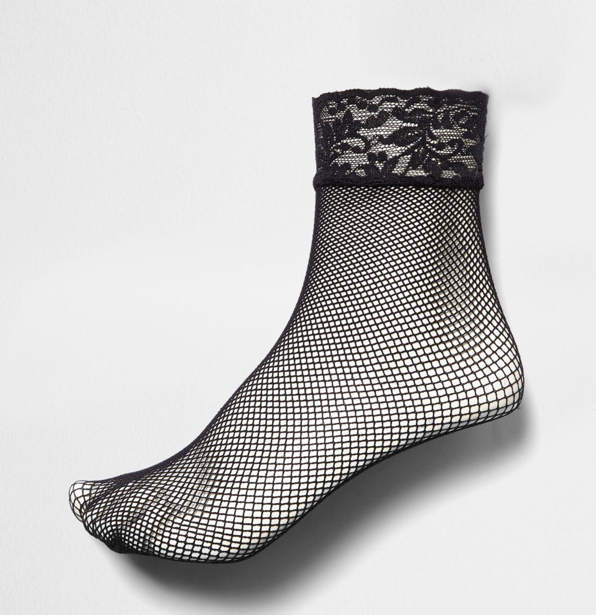 Chaussettes en résille noires à bordure en dentelle