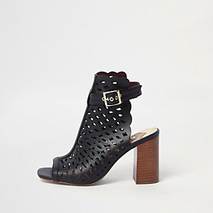 Black laser cut block heel shoe boots