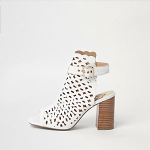 White laser cut block heel shoe boots