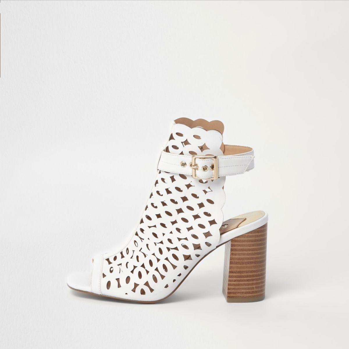 White laser cut block heel shoe boots
