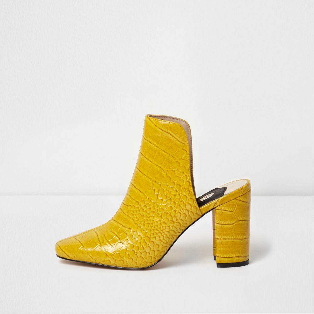 Yellow croc block heel mules