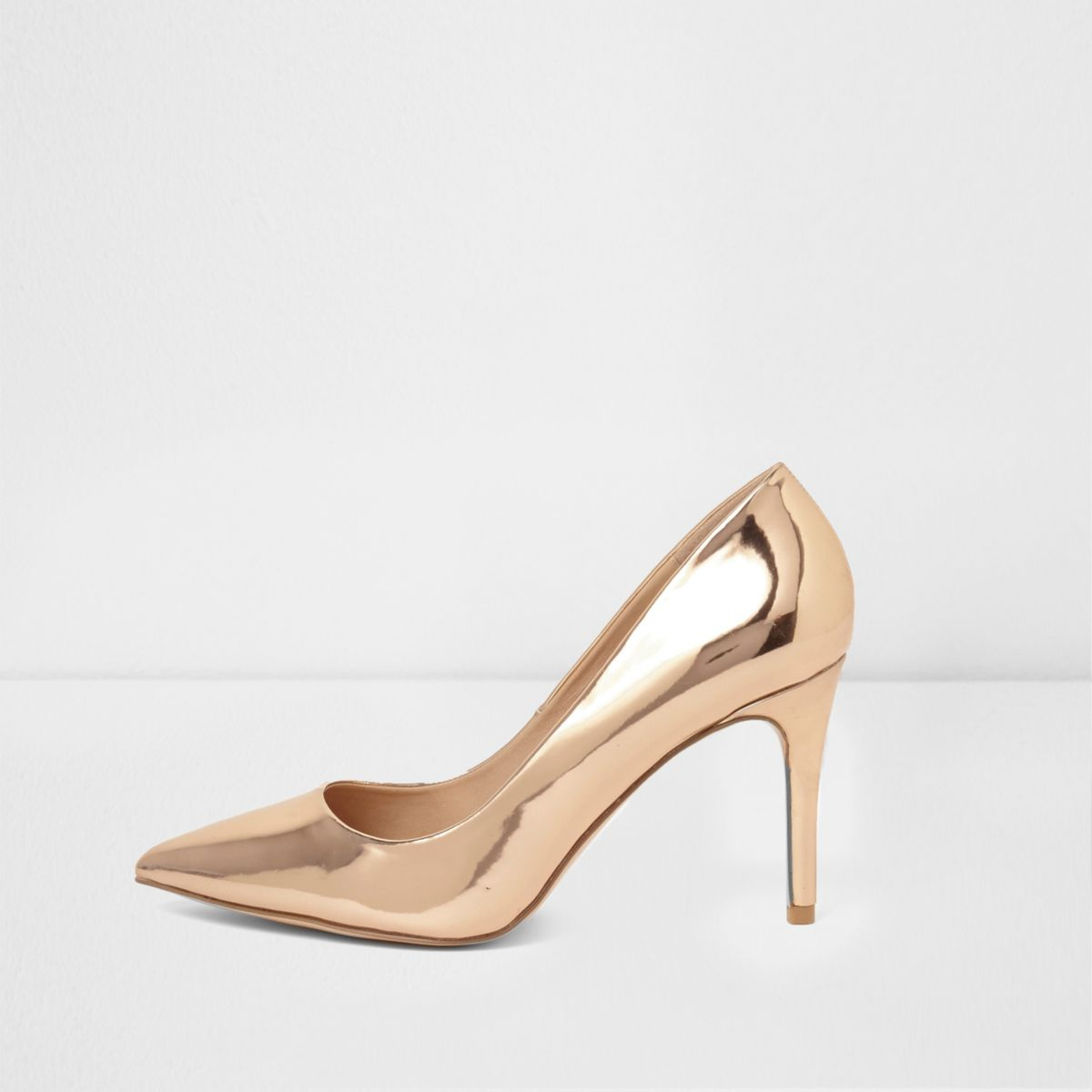 Rose gold metallic mid heel pumps