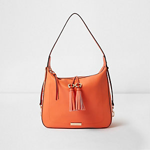 Bright orange tassel tab slouch bag