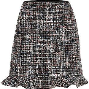 Mini-jupe en bouclette gris foncé avec ourlet à volant