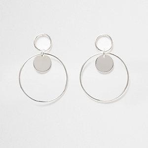 Silver tone double hoop disk earrings