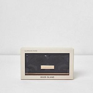 Schwarze Geldbörse mit Clipverschluss und Ausschnitt