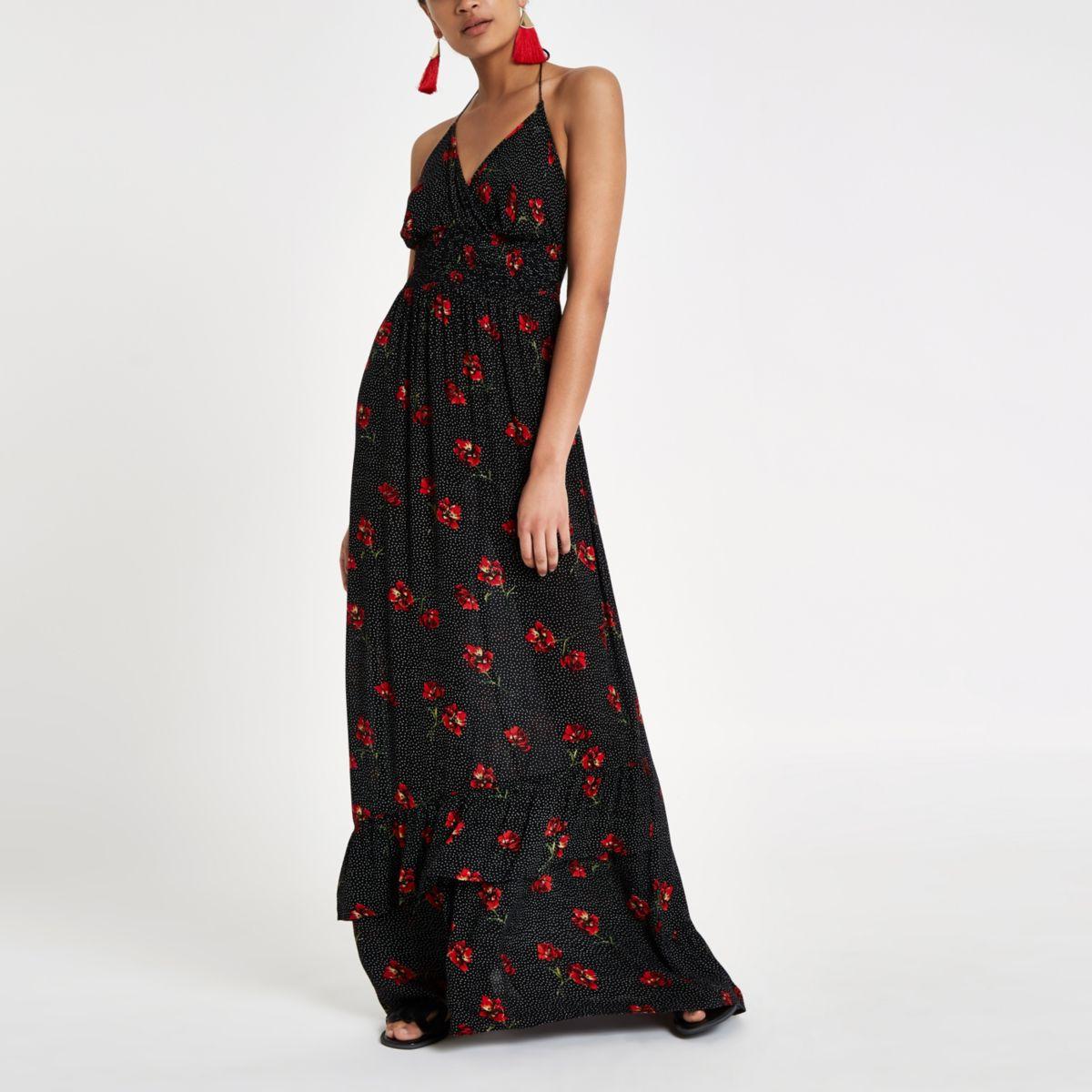 Robe longue noire à dos nu avec imprimé floral et pois