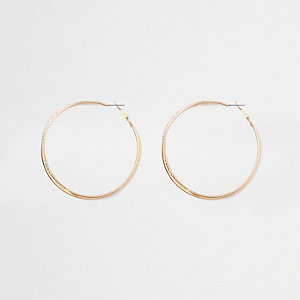 Gold tone double hoop rhinestone earrings