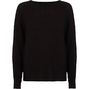 Zwarte geribbelde gebreide pullover met strik op de rug