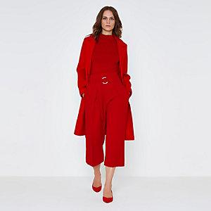 Rode broekrok met hoge taille en strikceintuur met ring
