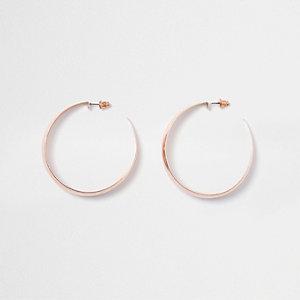 Rose gold tone flat hoop earrings