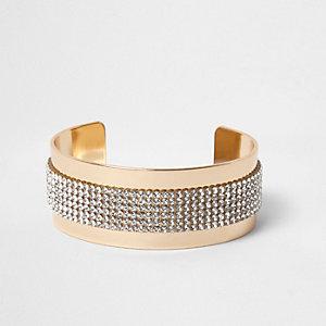 Goudkleurige brede armband met siersteentjes
