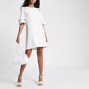White pearl neck frill sleeve swing dress