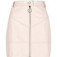 Light pink faux leather zip front mini skirt