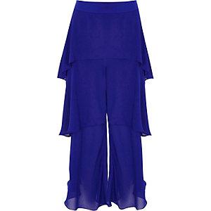 Blauer, gestufter Hosenrock mit Rüschen