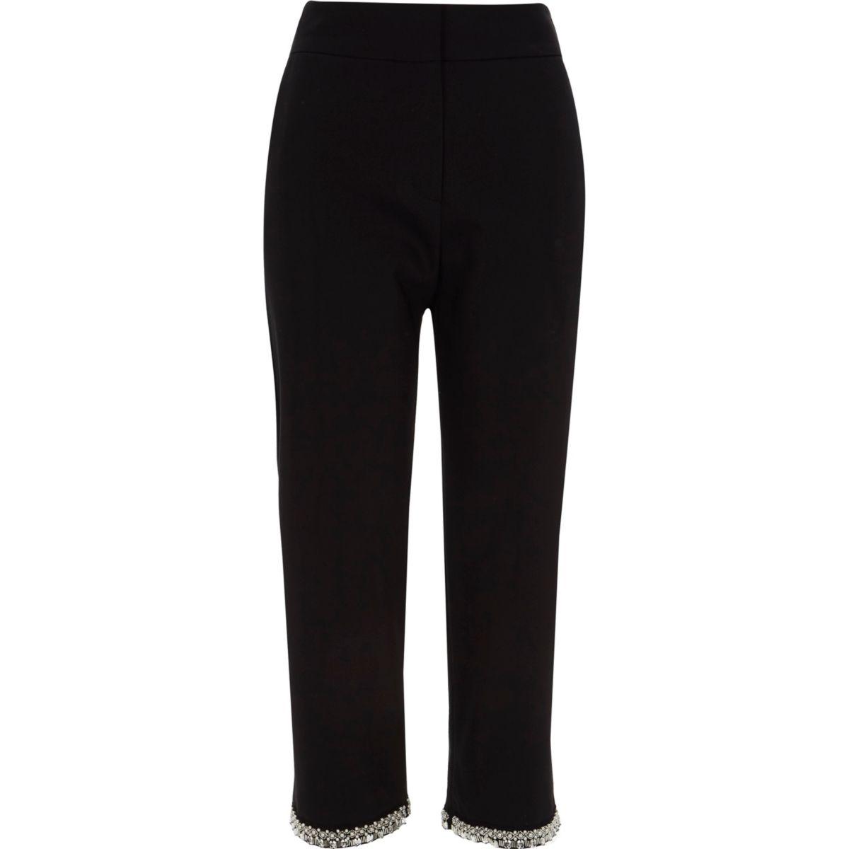 Zwarte smaltoelopende broek met verfraaide zoom