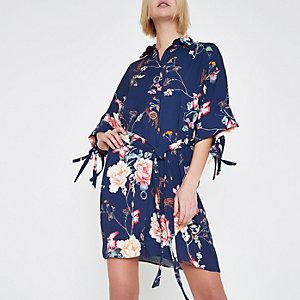 Robe chemise à fleurs bleue avec liens aux manches