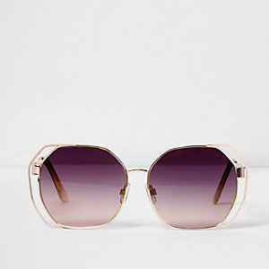 Oversized zonnebril met uitsneden en paarse glazen