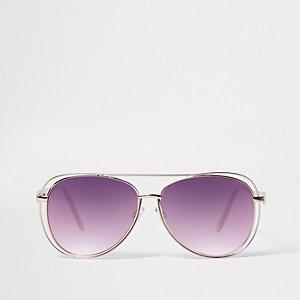 Pilotenzonnebril met openingen in het montuur en roze glazen