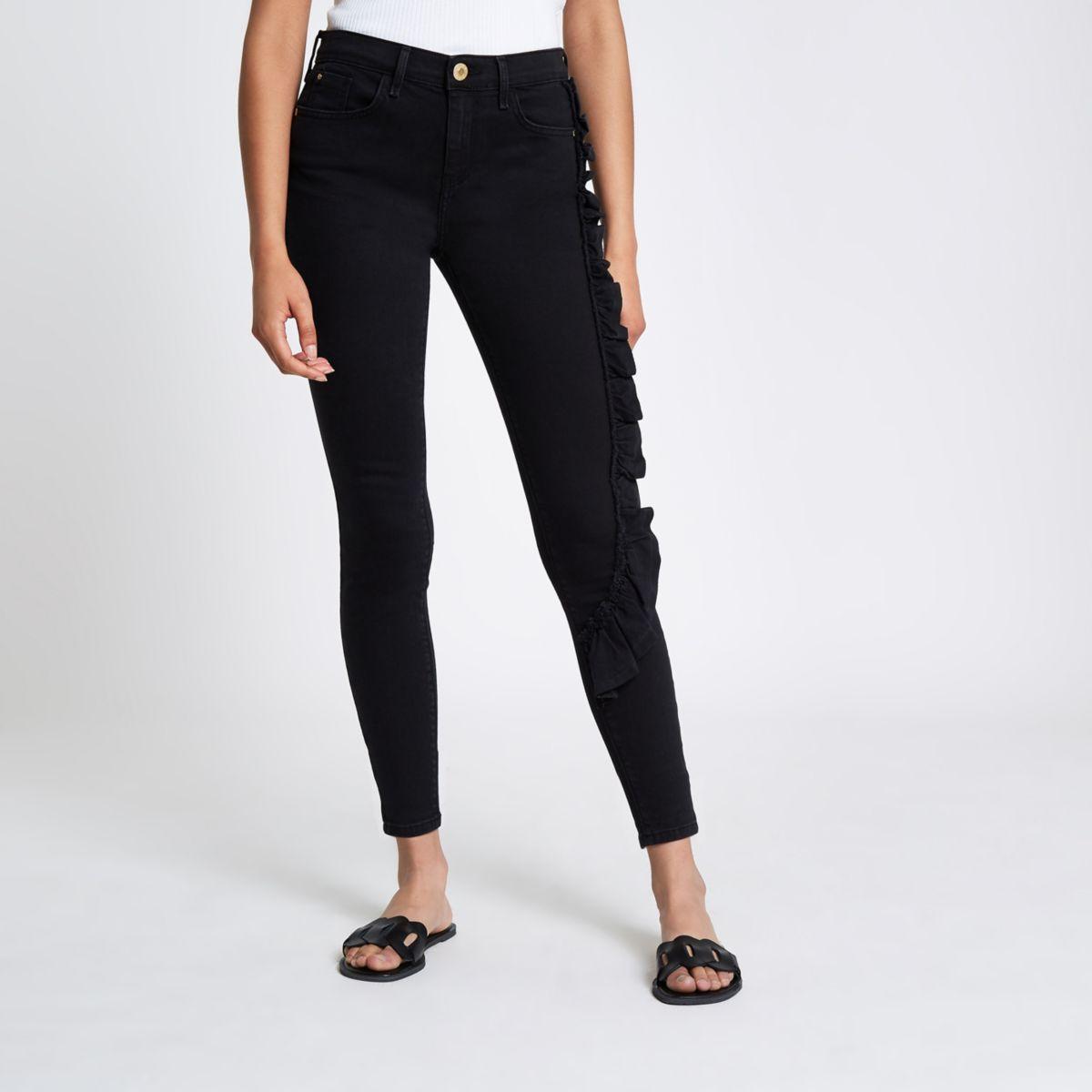 Amelie - Zwarte superskinny jeans met ruches