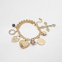 Gold tone star cross charm bracelet