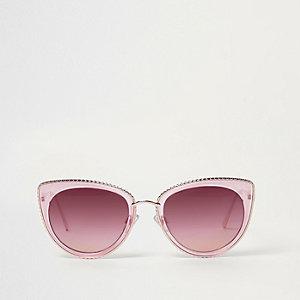 Rosa Cateye-Sonnenbrille mit goldfarbener Verzierung