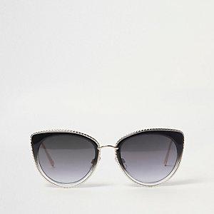 Schwarze Cateye-Sonnenbrille mit goldfarbener Verzierung