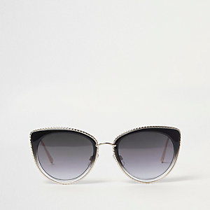 Zwarte cat-eye-zonnebril met goudkleurige rand
