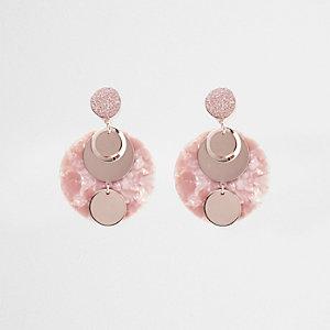 Roze oorhangers met kwartz schijf en glitters
