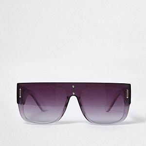 Zwarte zonnebril met platte bovenzijde en grijze glazen