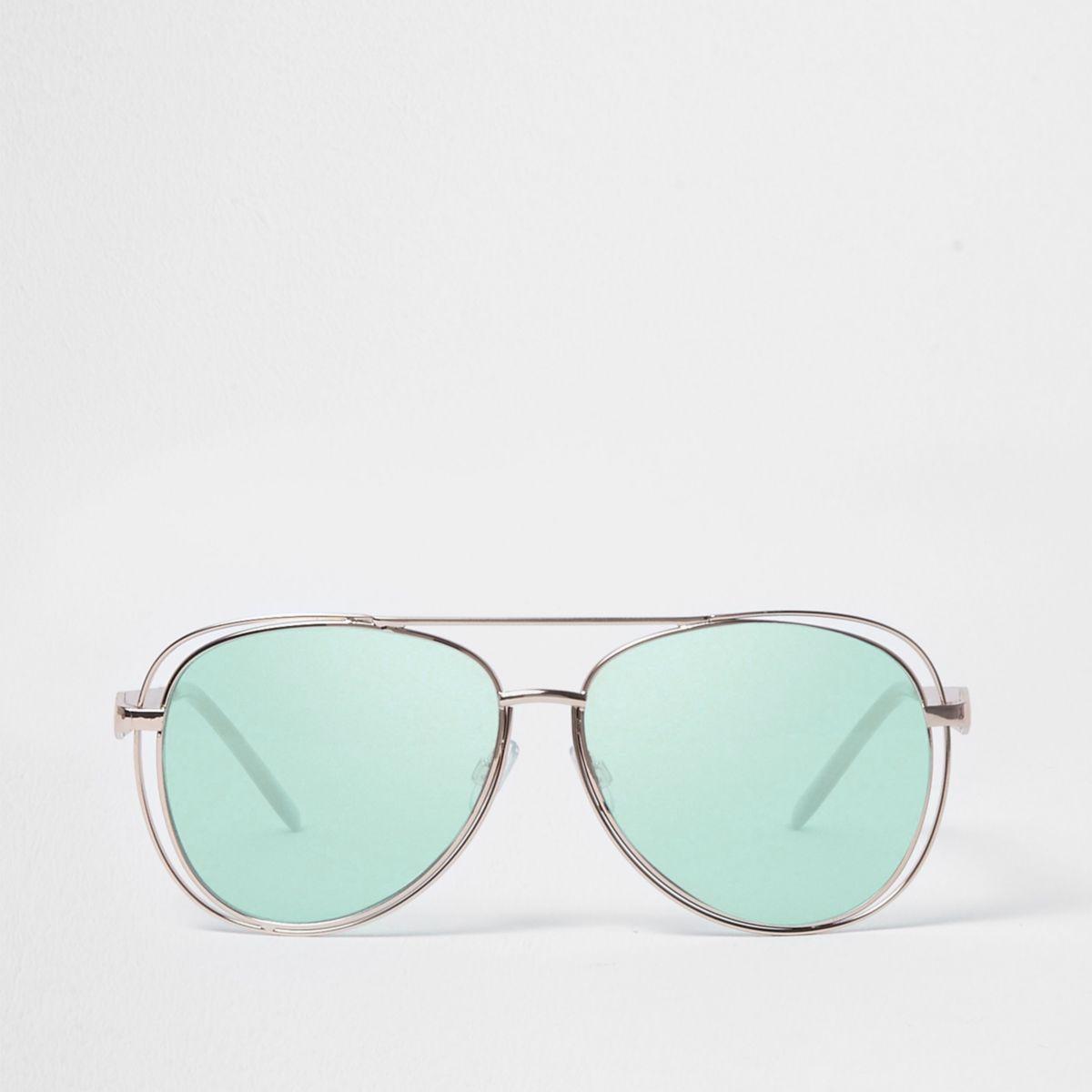 Pilotenzonnebril met groene glazen en uitsnede in het montuur