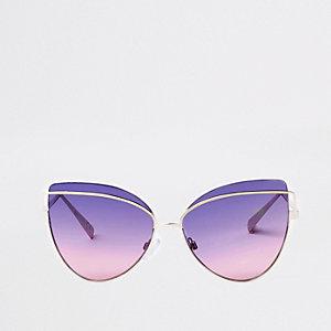 Goudkleurige zonnebril met ronde, blauwpaarse glazen