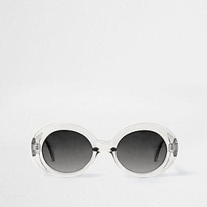 Lichtgrijze zonnebril met ovale rookglazen