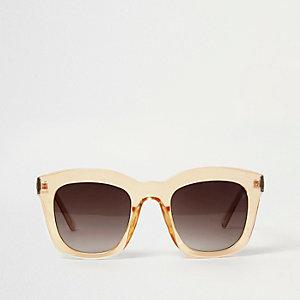 Donkergele glamzonnebril met doorzichtig montuur