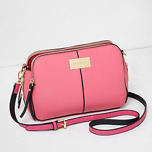 Bright pink triple compartment cross body bag