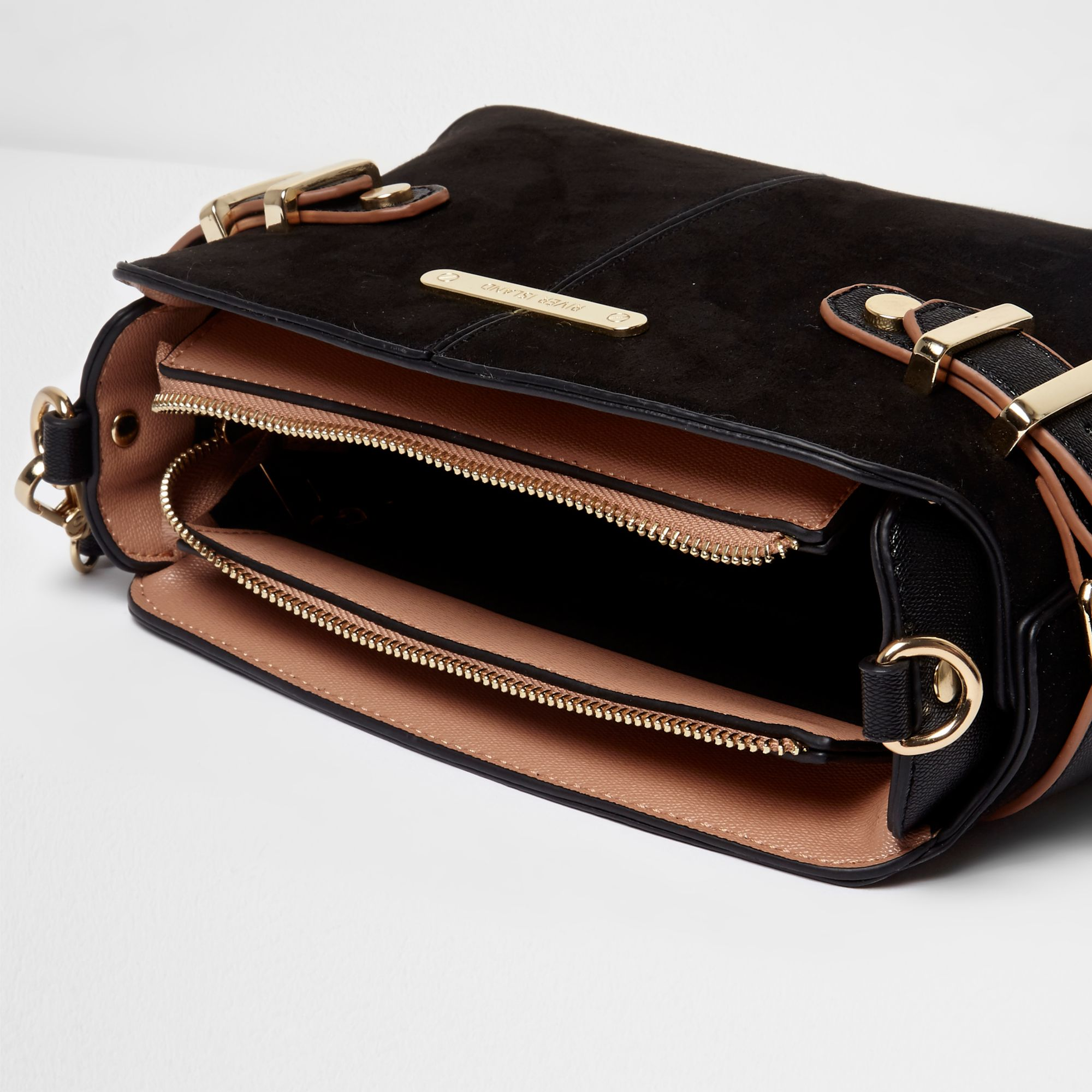 586186eab2 River Island Black tab buckle side cross body bag at £32