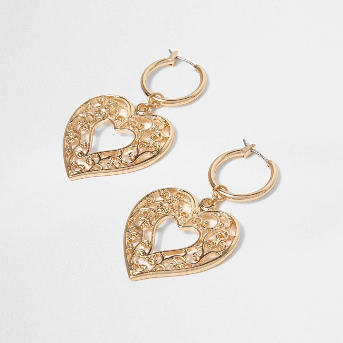 Gold tone heart dangle hoop earrings